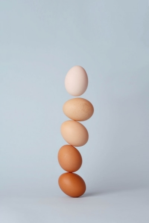 five eggs balanced on top of each other