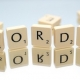"""Scrabble tiles spelling out """"words"""""""