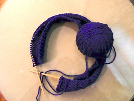 blue yarn ball being knitted