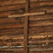 log cross on log cabin wall