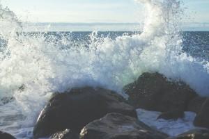 ocean water crashing on rocks