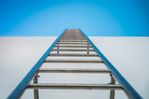 ladder on the side of a building, into the sky