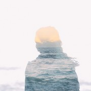 female silhouette with water and a horizon in the silhouette