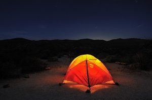 Marmot tent lit up at night