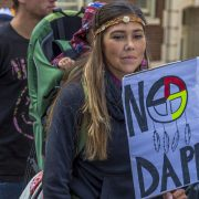 "Protestor holding a sign saying, ""No DAPL"""