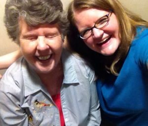 Sarah Ross, the author, and her grandmother, laughing as they take a selfie