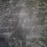 chalkboard with mathematical equations on it