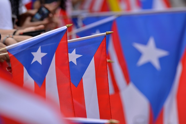 Puerto Rican flags hanging downward - red and white stripes with a white star in a blue triangle