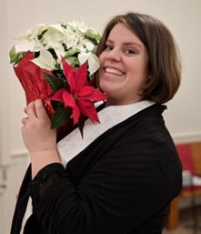 picture of author with a poinsettia