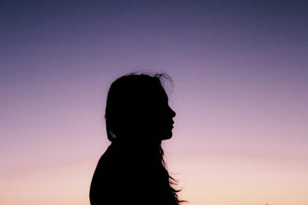silhouette profile of a woman with long hair