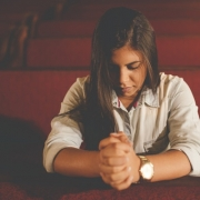 Woman praying alone in church