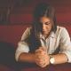 Woman praying alone in church