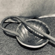 shepherd's staff and shell-shaped metal bowl