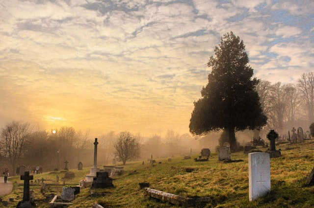 cemetery on a hill at sunrise
