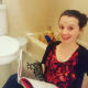 the author and her chicken in a bathtub