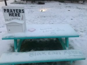 Picnic table and prayer mailbox in snow